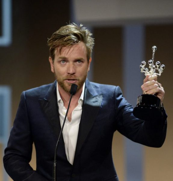 Scottish actor McGregor hold up his Donostia Award For Lifetime Achievement at the Kursaal Centre on the seventh day of the 60th San Sebastian Film Festival